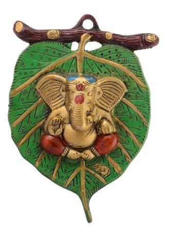 Flat 78% off on eCraftIndia Lord Ganesha on Leaf White Metal Wall Hanging (15 cm x 1.25 cm x 22.5 cm)