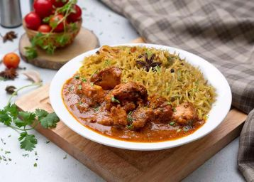 Smoked Butter Chicken Rice Bowl + Extra Egg At Rs.60 + Free Delivery